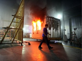 Researchers conduct a burn test at the National Research Council fire lab in Mississippi Mills.