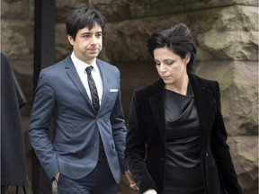 Jian Ghomeshi leaves court in Toronto on Thursday, March 24, 2016 with his lawyer Marie Henein. Ghomeshi was acquitted on all charges of sexual assault and choking following a trial that sparked a nationwide debate on how the justice system treats victims.