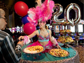 The Casino du Lac Leamy is celebrating its 20th anniversary in style by having colourful characters handing out 4000 sweet macarons to customers. Thursday March 24, 2016. Errol McGihon
