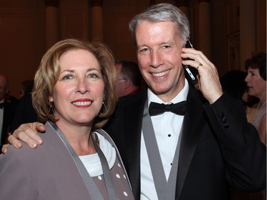Liberal MP Kim Rudd with Orleans MP and Chief Government Whip Andrew Leslie (on his cell phone) at the Politics and Pen dinner held at the Fairmont Chateau Laurier on Wednesday, April 20, 2016, in support of The Writers' Trust of Canada.