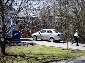 A mailman leaves Karla Homolka's home on April 20 in Châteauguay, Que.