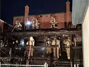 Ottawa Fire crews overhaul the rear additions and decks at a two-alarm fire on Rosemere Avenue on Saturday, April 30, 2016.