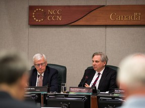 Russell Mills, (L) NCC Chair, and Mark Kristmanson, CEO, as the NCC's board of directors announce their vote on recommendations on how to proceed with the development of LeBreton Flats at its Thursday meeting.