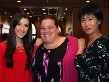 From left, volunteer Selin Kum with Lindy Rosko, board president of The Rehabilitation Centre Volunteer Association, and volunteer Pulan Wang at the 17th annual Spring into Motion charity auction and dinner, held Wednesday, May 18, 2016, at the St. Elias Centre.
