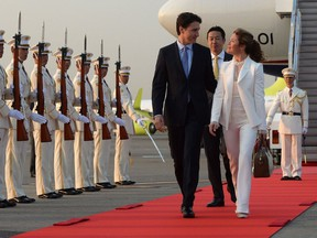 Prime Minister Justin Trudeau and wife Sophie Grégoire Trudeau are greeted by an honour guard as they arrive in Tokyo, Japan on Monday, May 23, 2016. One letter-writer says they should have been paying attention to the guards, not each other.
