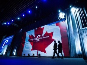 Former prime minister Stephen Harper, left, and his wife Laureen Harper walk on stage for his address to delegates during the 2016 Conservative Party Convention, in Vancouver, B.C. on Thursday May 26, 2016.