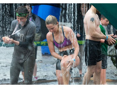 Competitors wash off the mud at the end as the Mud Hero Ottawa 2016 continued on Sunday at Commando Paintball located east of Ottawa.