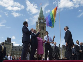 Prime Minister Justin Trudeau takes part in a pride flag raising ceremony on Parliament Hill, Wednesday, June 1, 2016 in Ottawa.