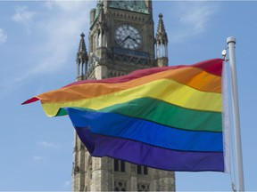 The pride flag flies following a raising ceremony on Parliament Hill Wednesday June 1.
