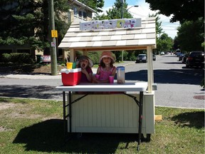 Eliza, 7,  and Adela, 5, at their lemonade stand on the median facing Echo drive.