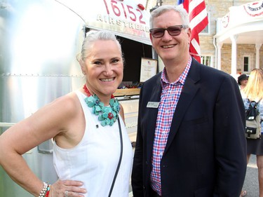 Ann Rickenbacker, director of catering at The Westin Ottawa, with the hotel's general manager, Ross Meredith, at the U.S. Embassy's road trip-themed 4th of July party, catered by The Westin, on Monday, July 4, 2016, at Lornado, the official residence of the U.S. ambassador and his wife.