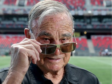 """Former Ottawa Rough Rider coach George Brancato, takes in TD Place for the first time Thursday (July 21, 2016) during a Redblacks practice.  """"Wow, looks great,"""" exclaimed the multiple Grey Cup winner, now 85 years old, as he surveyed the new stadium and stands.  Julie Oliver/Postmedia"""