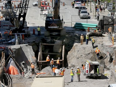 Day 7: Repair work continues on the sinkhole at Rideau near Sussex in downtown Ottawa.