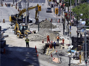 Day 12: Repairs on the Ottawa Sinkhole on Rideau St. continue Sunday June 19, 2016.