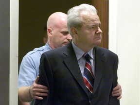 DECADE IN PICTURES Former Yugoslav president Slobodan Milosevic is led into the courtroom of the UN War Crimes Tribunal in The Hague, July 3, 2006, for his first appearance before the body. Milosevic will represent himself at the hearing, where he will be asked to answer charges of war crimes committed during the 1998-99 Serbian crackdown on ethnic Albanians, according to a lawyer who met him on Monday. Milosevic, who will become the first former head of state to be prosecuted but the International Criminal Tribunal for the former Yugoslavia (ICTY), faces life behind bars if convicte