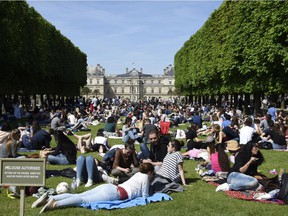 People enjoy the sunny and warm weather at the Luxembourg Garden in Paris on May 5, 2016.  / AFP / DOMINIQUE FAGET        (Photo credit should read DOMINIQUE FAGET/AFP/Getty Images) ORG XMIT: 067