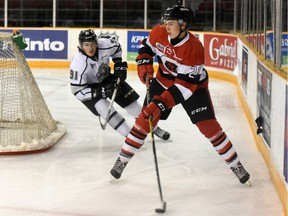 Ottawa 67's defenceman Carter Robinson fends off  Zack MacEwen of the Gatineau Olympiques during the first period of Sunday's exhibition game between the team's at TD Place.