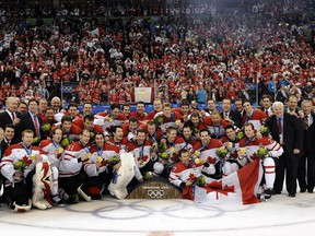 Sarnia's Doug Armstrong was an architect of the men's Olympic hockey team that won the gold medal at the Vancouver Winter Olympics. He posed with the team for this iconic photo at GM Place in Vancouver  on  Feb. 28, 2010.