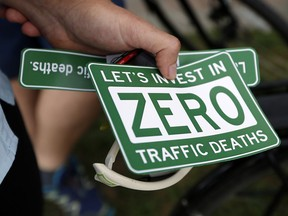 Is it possible to lessen traffic fatalities with both trucks and cyclists on the road? (Photo: Darren Brown/Ottawa Citizen) Assignment 124656