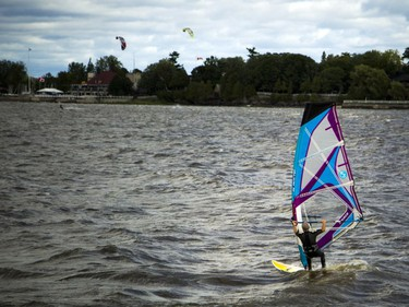 High winds brought the kiteboarders and windsurfers out to the Ottawa River just out from Britannia Beach Sunday September 11, 2016.   Ashley Fraser / Postmedia