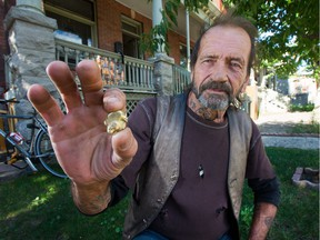 Larry Mantha displays the golden nugget he found. A pawn shop has offered him $309 for it but he's not sure he wants to sell.