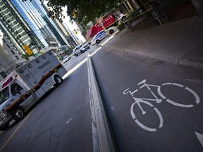 Ottawa Police are investigating the death of a cyclist after a collision with a truck at the corner of Laurier and Lyon Street Thursday September 1, 2016.