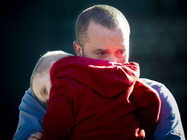 RCMP Const. Sarah Beckett's husband, Brad Aschenbrenner, and one of their sons, Emmit Aschenbrenner, are seen at a ceremony honouring them on Parliament Hill on Saturday, Sept. 24, 2016. Beckett was killed in a crash in Langford, B.C., on April 5, 2016. She was 32.