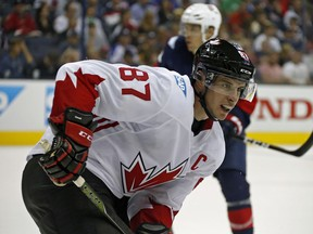 Team Canada' Sidney Crosby, seen Friday night against Team USA,  gets the night off in Ottawa after a physical first meeting.