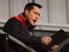 Ottawa Senators head coach Guy Boucher watches his team during day two of training camp in Ottawa on Friday, Sept. 23, 2016.