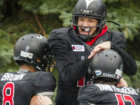From left, the Carleton Ravens' Phil Iloki, Wilson Birch and Kyle VanWynsberghe celebrate in the end zone during the game against Ottawa University Gee-Gees at MNP Park on Saturday, Oct. 29, 2016.