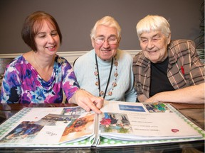 Annie Herweyer, centre, looks through a photo album with her daughter, Marianne Sabourin, left, and friend Betty Hay. Herweyer lived out her dream of returning to Holland to visit her brother.