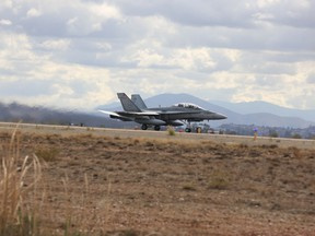 MARINE CORPS AIR STATION MIRAMAR, Calif.— Service members with 4 Wing, Royal Canadian Air Force, conduct exercise PUMA STRIKE with 24 CF-188 Hornet fighter aircraft board Marine Corps Air Station Miramar, Calif., Oct. 31. Twice a year, 410 Tactical Fighter (Operational Training) Squadron deploys to locations in the southern United States to conduct fighter training operations. (U.S. Marine Corps photo by Lance Cpl. Jacob Pruitt/Released)