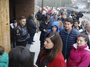 Crowds line up for a multifaith solidarity event at Congregation Machzikei Hadas synagogue in Ottawa on Saturday, November 19, in response to recent acts of hate vandalism.