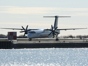 Porter Airlines plane, a Bombardier Q400 turboprop, prepares for takeoff at the Toronto City Centre airport, Friday, February 13, 2009.