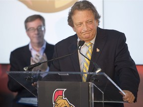 Ottawa Mayor Jim Watson, left, looks on as Ottawa Senators' owner Eugene Melnyk speaks during a press conference in this file photo. Can they come up with a deal for an outdoor NHL game in 2017?