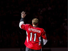 Daniel Alfredsson salutes the crowd after skating with the Ottawa Senators one last time in Ottawa on Thursday December 4, 2014.
