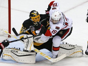 The Ottawa Senators' Derick Brassard collides with Penguins goalie Marc-Andre Fleury in the first period in Pittsburgh on Monday, Dec. 5, 2016. Brassard was penalized for goaltender interference.