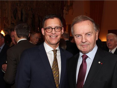 From left, Serge Sasseville, senior vice president of corporate and institutional affairs at Quebecor Media with Senator Serge Joyal, a former cabinet minister in the Pierre Trudeau government, at the Embassy of France on Tuesday, December 6, 2016, for the induction of former prime minister Brian Mulroney into the French Legion of Honour.