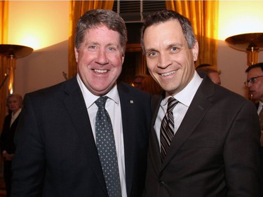 From left, St. Francis Xavier University president Kent MacDonald (also former president of Algonquin College), with Algonquin College board member Mark Sutcliffe at the Embassy of France on Tuesday, Demcember 6, 2016, for former prime minister Brian Mulroney's induction into the French Legion of Honour.
