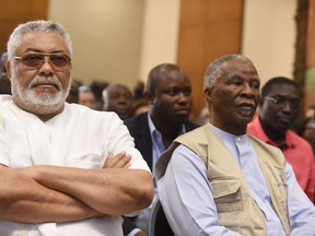 Former Ghanaian President Jerry Rawlings (L) and former South African President and head of African Union mornitoring group Thabo Mbeki look on as presidential candidates sign peace pact ahead of the Dec. 7 polls in Accra.