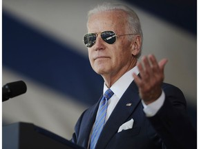 In this May 2015 photo, Vice President Joe Biden gestures after donning a pair of sunglasses as he delivers the Class Day Address at Yale University in New Haven, Conn.