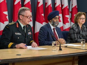 Chief of the Defence Staff, General Jonathan Vance, Defence Minister Harjit Sajjan, Minister of Public Services and Procurement, Judy Foote, announce on Nov. 22, 2016 the plan to begin negotiations on the purchase of Boeing Super Hornets. DND photo.