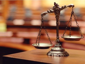 120115-Decorative_Scales_of_Justice-219116666-Decorative_Scales_of_Justice-W.jpg