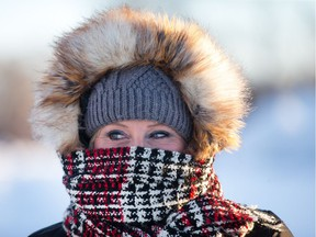 Michelle Lapointe is all bundled up on Viewmount Dr as the region is back into the deep freeze for the next few days.  Wayne Cuddington/ Postmedia
