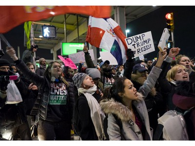 Protesters block an intersection near Terminal 4 at John F. Kennedy International Airport in New York.