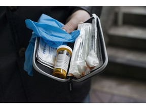 Garth Mullins holds a Naloxone anti-overdose kit in downtown Vancouver, Friday, Feb. 10, 2017.