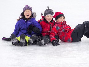 L-R: Seven-year-old Emma, five-year-old Sean and nine-year-old Draden Watkins loved Winterlude's giant ice slide in Jacques Cartier Park, Saturday, Feb. 4, 2017.