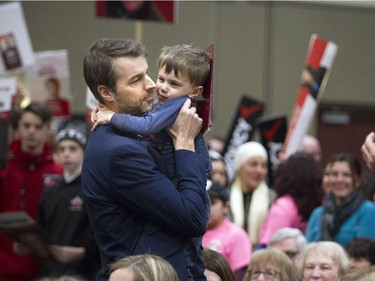 Nicolas Moyer gets a hug from his son three year old Owen Moyer after he finished his speech during the Liberal Party of Canada's candidate selection meeting for the upcoming Ottawa--Vanier federal by-election, a gathering to nominate their candidate on Sunday, February 5th, 2017.  Ashley Fraser/Postmedia