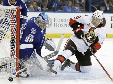 Ottawa Senators left wing Ryan Dzingel (18) shoots wide of Tampa Bay Lightning goalie Andrei Vasilevskiy, of Russia, during the first period of an NHL hockey game Thursday, Feb. 2, 2017, in Tampa, Fla.