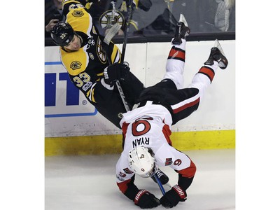 Ottawa Senators right wing Bobby Ryan (9) is upended as he collides with Boston Bruins defenseman Zdeno Chara (33) during the first period of an NHL hockey game in Boston, Tuesday, March 21, 2017.
